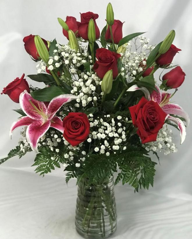 12 roses and 3 stargazer lilies