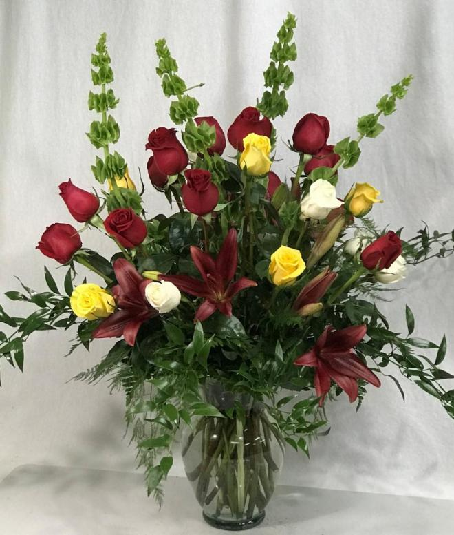 24 roses with lilies and bells