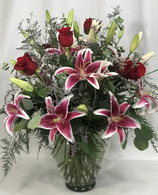 6 roses and 8 stargazer lilies